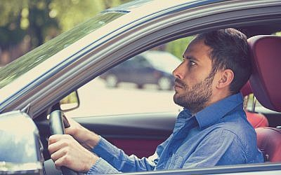 A stressed man driving a car. (SIphotography/iStock/Getty Images)