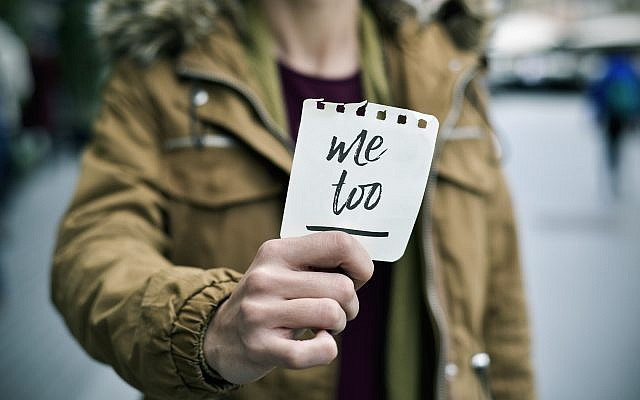 Illustrative image of a victim of sexual harassment holding a note with the text 'me too.' (nito100/iStock by Getty Images)
