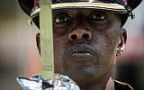 A Kenyan army soldier performs during the rehearsal of the inauguration ceremony of the president at the Moi International Sports Center's Kasarani Stadium in Nairobi on November 27, 2017. (AFP PHOTO / YASUYOSHI CHIBA)