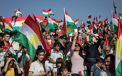 Kurdish people show their support for a referendum on independence for Kurdistan at a massive  rally held at the Erbil Stadium in Erbil, Iraq, on September 22, 2017. (Chris McGrath/Getty Images via JTA)