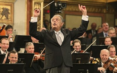 In this January 1, 2015 file photo, conductor Zubin Mehta appears with the Vienna Philharmonic Orchestra during the traditional New Year's concert at the Musikverein in Vienna, Austria. (AP Photo/Ronald Zak, File)