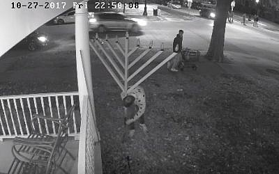 Security camera footage of University of Illinois students vandalizing the campus menorah in 2017 (YouTube screenshot)