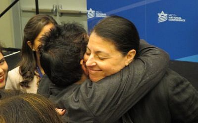 Zionist Union MK Merav Michaeli embraces a participant at the Israeli American Council's annual Washington conference, on Nov. 5, 2017. (Ron Kampeas/JTA)