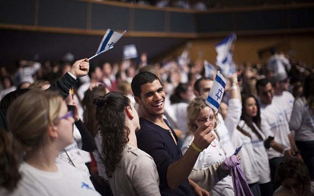Young Jewish adults from all over the world participating in the Taglit Birthright program celebrate 10 years of the Birthright program at an event held at the International Conference Center in Jerusalem on January 7, 2013. (Yonatan Sindel/Flash90)