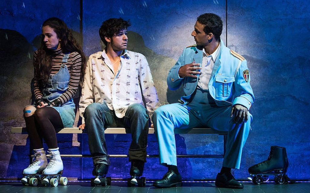 Ari'el Stachel, right, plays matchmaker to two shy Israelis, played by Rachel Prather and Etai Benson, in 'The Band's Visit.' (Matt Murphy/via JTA)