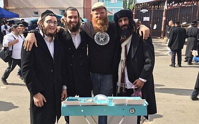 "Eitan Press, second from right, says he has ""anointed"" the beards of hundreds of men, including these Jewish pilgrims in Uman, Ukraine, Sept. 20, 2017. (Aleph Male)"