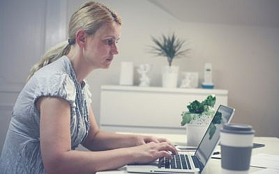 Illustrative photo of a woman at her computer (iStock/Liderina)