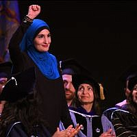 Linda Sarsour speaking at the CUNY Graduate School of Public Health's inaugural commencement ceremony at the Apollo Theatre in New York City, June 1, 2017. (Timothy A. Clary/AFP/Getty Images via JTA)
