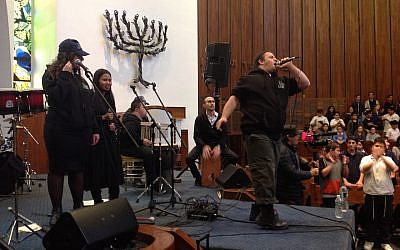 Yair Pomburg raps during a performance of the Shalva Band at North Shore Hebrew Academy on Long Island. (Ben Sales via JTA)