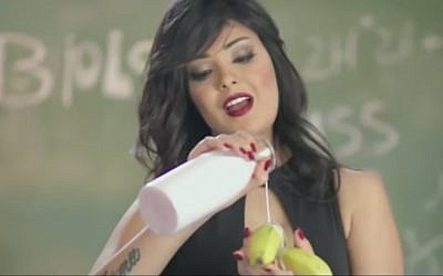 "The singer Shyma, enjoying some milk and a banana in her video ""I Have Issues."" (screen capture: YouTube)"