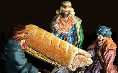 An advert for UK bakery chain Greggs showing the Three Wise Men worshiping a sausage roll. (Taylor Herring/Greggs/PA)