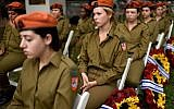 Female soldiers participate in an official ceremony marking Israel's Memorial Day, one day ahead of Israel's 69'th Indepedence Day in Kiryat Shaul military cemetery, Tel Aviv, on May 1, 2017. (Gili Yaari/Flash90)