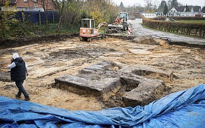 The giant swastika-shaped base of a Nazi-era statue  discovered on a construction site for a sports field in Hamburg, northern Germany, November 21, 2017. (Christian Charisius/dpa via AP)