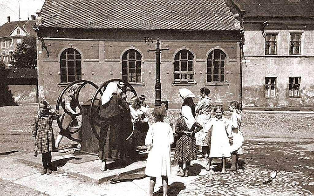 In Oswiecim, Poland, a water well is used in front of the so-called 'Auschwitz Synagogue' near the center of town, interwar period (Auschwitz Jewish Center)
