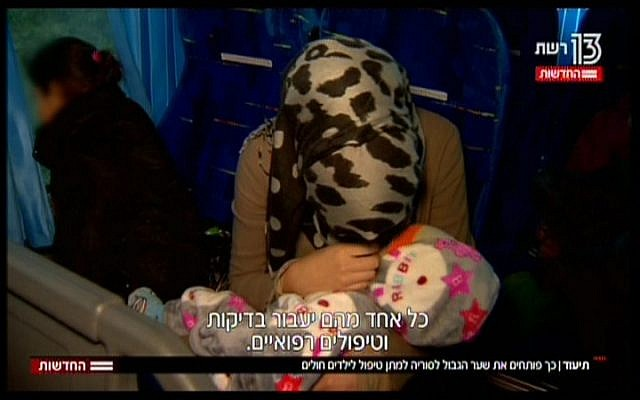 Syrian medical patients in Israel, seen in a TV report broadcast on November 19, 2017 (Hadashot News screenshot)