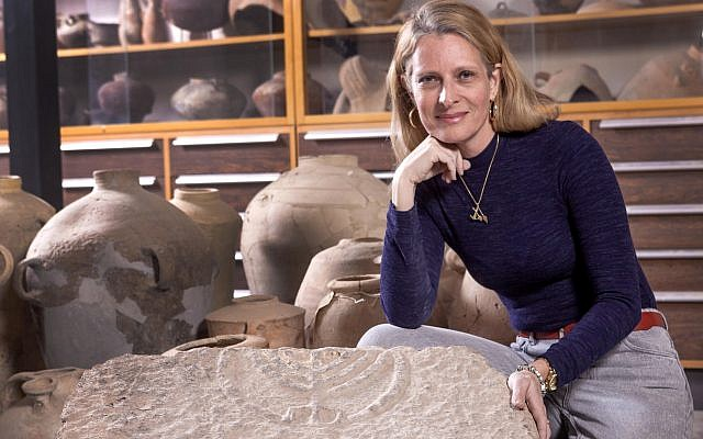 Hebrew University's Dr. Katya Tzitrin Silverman with the circa 1,800-year-old menorah found in Tiberius. (Tal Rogoveski)