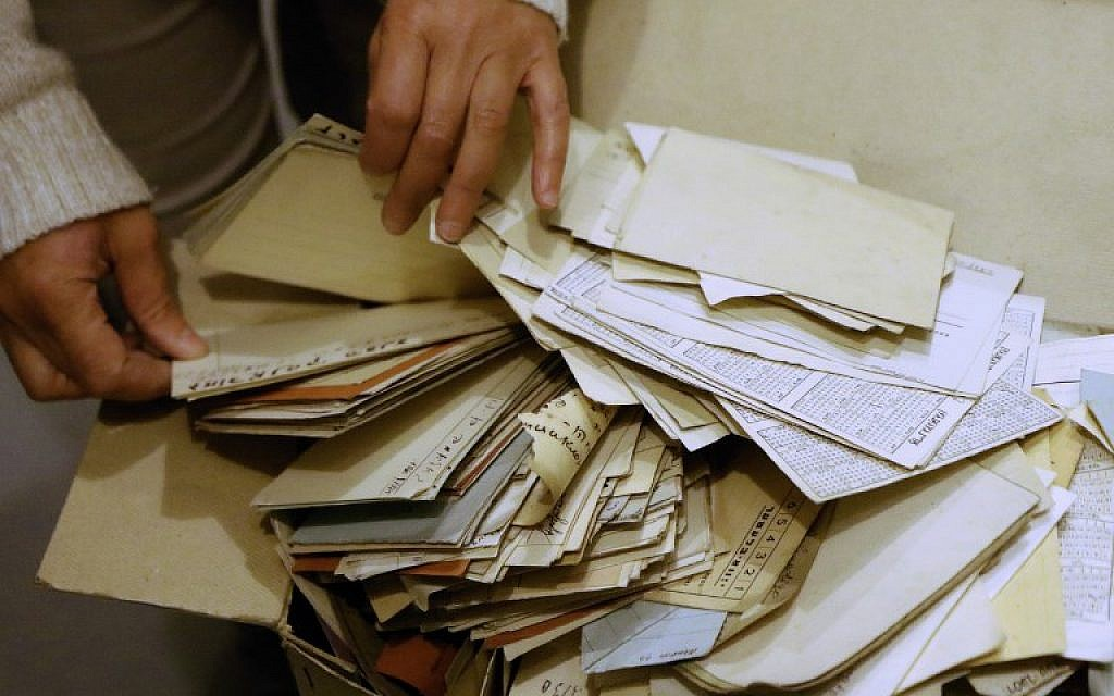 Judaica Research Centre chief Lara Lempertiene files through rediscovered Jewish documents, long thought to have been destroyed during World War II, in Lithuanian national library in Vilnius on November 3, 2017. (AFP PHOTO / Petras Malukas)