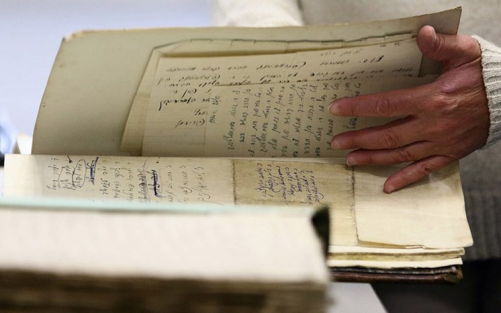 Judaica Research Centre chief Lara Lempertiene shows rediscovered Jewish documents, long thought to have been destroyed during World War II, in Lithuanian national library in Vilnius on November 3, 2017. (AFP PHOTO / Petras Malukas)