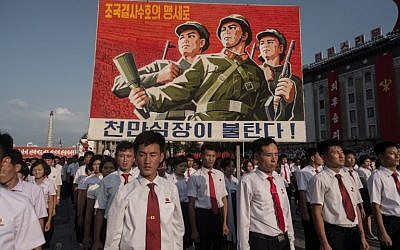 A propaganda poster is displayed during a rally in support of North Korea's stance against the US, on Kim Il-Sung square in Pyongyang on August 9, 2017.  (AFP Photo/Kim Won-Jin)