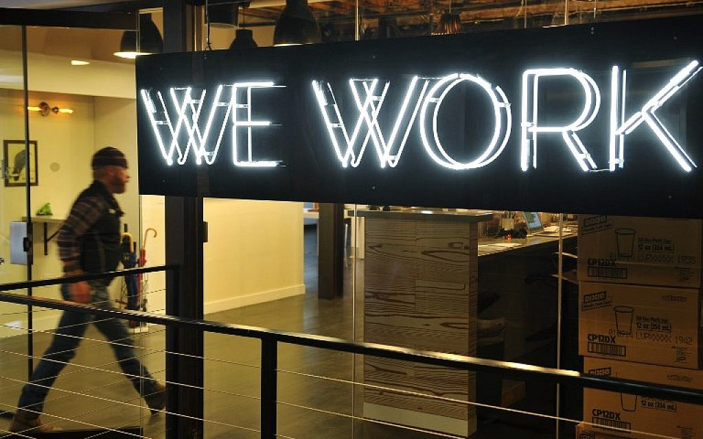 Embattled WeWork puts on hold plan to open co-living spaces in Israel