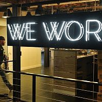A man enters the WeWork cooperative co-working space in Washington, DC, on March 13, 2014. (AFP/Mandel Ngan)