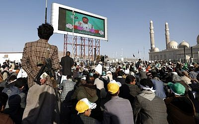 Shiite Houthi rebels and their supporters watch on a big screen a live speech given by leader Abdul-Malik al-Houthi, as they attend a rally outside al-Saleh mosque in the capital Sanaa on the occasion of the Prophet Mohammed's birthday on November 30, 2017.(AFP PHOTO / MOHAMMED HUWAIS)