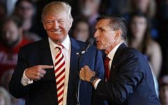 This file photo taken on October 17, 2016, shows Donald Trump (L) and Michael Flynn at a rally at a campaign rally in Grand Junction, Colorado. (AFP Photo/Getty Images North America/George Frey)