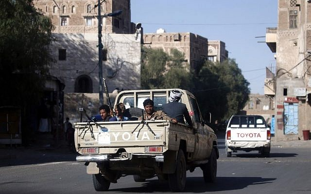 Houthi fighters sit in the back of a pick-up truck in the Yemeni capital Sana'a on December 2, 2017. (AFP Photo/Mohammed Huwais)