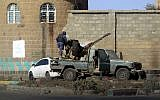 Houthi fighters man an anti-aircraft gun during clashes with supporters of Yemeni ex-president Ali Abdullah Saleh in the Yemeni capital Sanaa, December 2, 2017. (MOHAMMED HUWAIS/AFP)