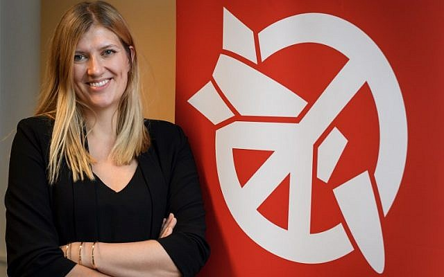 Beatrice Fihn, executive director of 2017 Nobel Peace Prize-winning International Campaign to Abolish Nuclear Weapons (ICAN), poses next to the ICAN logo at their headquarters during an interview with AFP on November 30, 2017 in Geneva. (AFP/Fabrice COFFRINI)