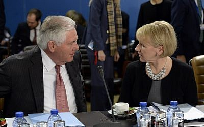 Swedish Foreign Minister Margot Wallstrom, right, speaks with US Secretary of State Rex Tillerson before a NATO Foreign Affairs Ministers' meeting held at NATO headquarter in Brussels, December 5, 2017.  (THIERRY CHARLIER/AFP)