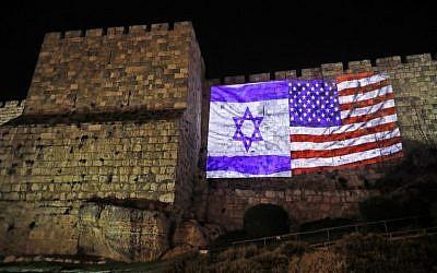 A giant US flag screened alongside Israel's national flag on the walls of the Old City in Jerusalem, December 6, 2017. (Ahmad Gharabli/AFP)