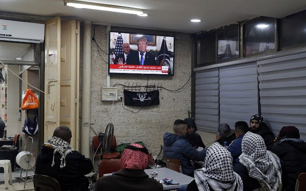 Palestinians sitting in a Jerusalem cafe watching an address given by US President Donald Trump about the city, December 6, 2017  (Ahmad GHARABLI/AFP)