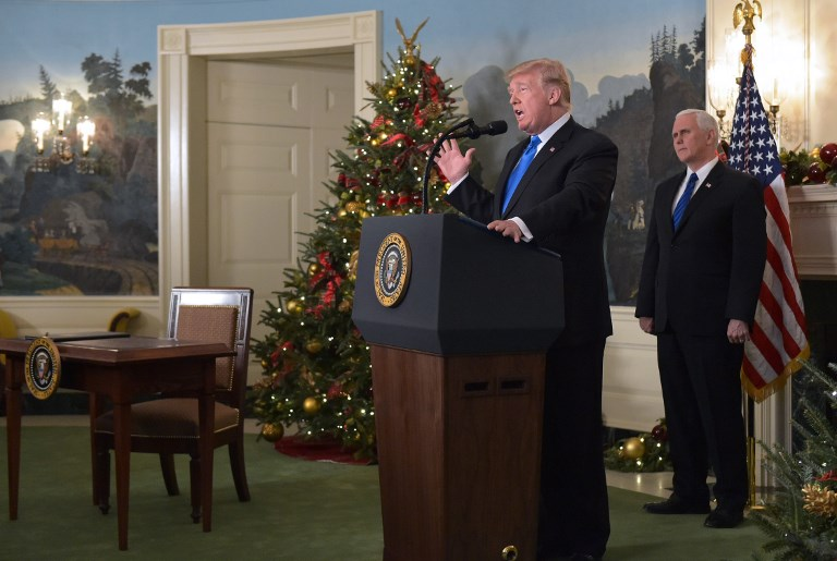 US President Donald Trump delivers a statement on Jerusalem as US Vice President Mike Pence looks on in the Diplomatic Reception Room of the White House in Washington DC