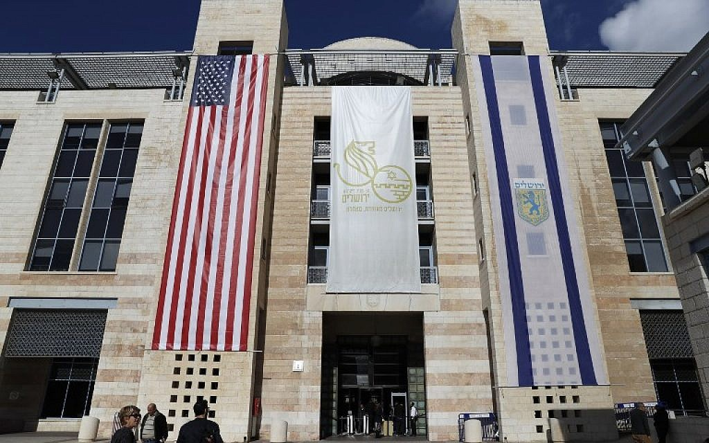 The US and Israeli flags hang at the entrance of Jerusalem Municipality building following US President Donald Trump's decision to recognize the city as the capital of Israel on December 7, 2017. (Ahmad GHARABLI/AFP)