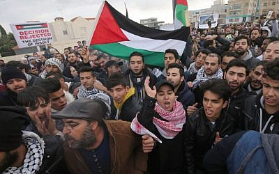 Protesters shout slogans and wave the Jordanian flag during a demonstration near the American Embassy in Amman against US President Donald Trump's decision to recognize Jerusalem as the capital of Israel on December 7, 2017.   (AFP/Khalil Mazraawi)