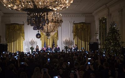 US President Donald Trump speaks during a Hanukkah reception in the East Room of the White House in Washington, DC, December 7, 2017. (AFP PHOTO / SAUL LOEB)