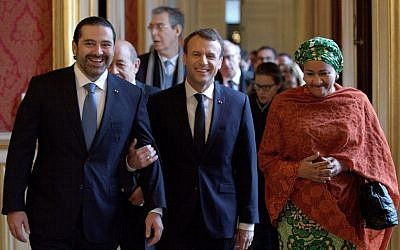 French President Emmanuel Macron (C) walks between Lebanon's Prime Minister Saad Hariri (L) and UN Deputy Secretary General Amina Mohammed (R) as they arrive to attend the Lebanon International Support Group meeting in Paris on Decdember 8, 2017. (AFP/Pool/Philippe Wojazer)