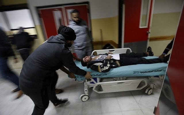 An injured Palestinian man arrives at a hospital to receive treatment following an Israeli air strike in Beit Lahia, in the northern Gaza Strip, on December 8, 2017 .(AFP PHOTO / MOHAMMED ABED)