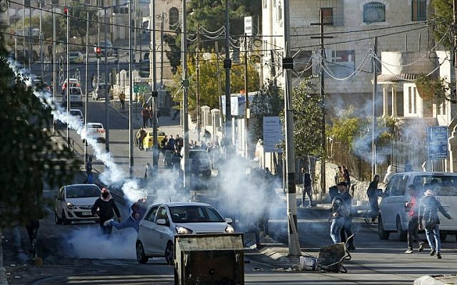 Palestinian protesters clash with Israeli forces near an Israeli checkpoint in the West Bank town of Bethlehem on December 9, 2017, following the US president's decision to recognize the city of Jerusalem as the capital of Israel. ( AFP PHOTO / Musa AL SHAER)