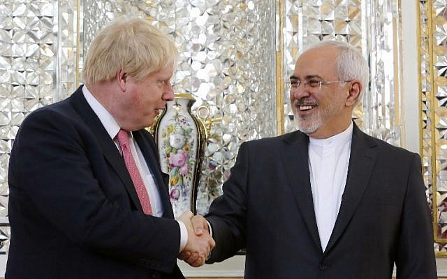 Iran's Foreign Minister Mohammad Javad Zarif (R) shakes hands with his British counterpart Boris Johnson during a meeting in Tehran on December 9, 2017. (AFP Photo/Atta Kenare)