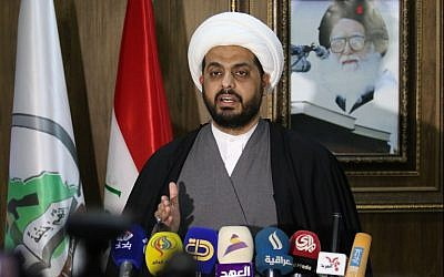 This file photo taken on January 8, 2016 shows Qais Al-Khazali, the head of the Iraqi Asaib Ahl al-Haq militia, speaking at a press conference in the southern Iraqi city of Basra. (AFP Photo/Haidar Mohammed Ali)
