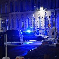 Police arrive after a synagogue was attacked in a failed arson attempt in Gothenburg, Sweden, late December 9, 2017. (AFP/TT News Agency/Adam IHSE)