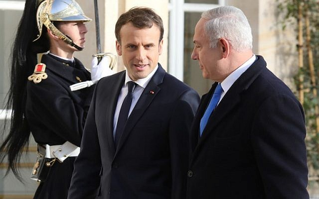 French President Emmanuel Macron, left, welcomes Prime Minister Benjamin Netanyahu upon his arrival at the Elysee Palace on December 10, 2017 in Paris. (AFP/Ludovic Marin)