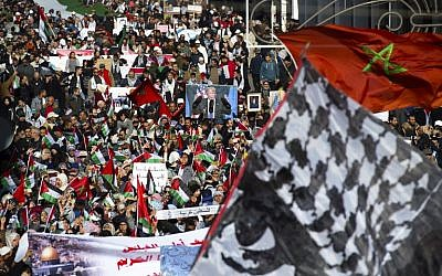 Illustrative: Pro-Palestinian protesters wave Palestinian and Moroccan flags during a demonstration in Rabat against US President Donald Trump's declaration of Jerusalem as Israel's capital on December 10, 2017 (AFP PHOTO / FADEL SENNA)