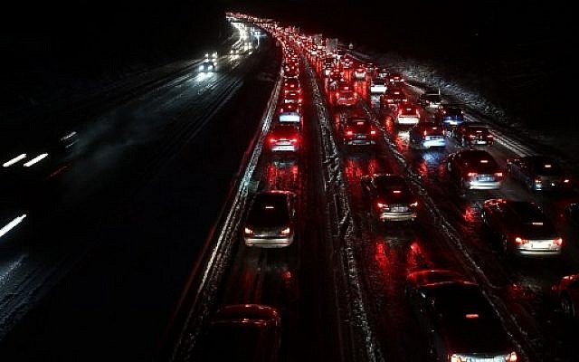 After heavy snowfall, traffic stands almost still on motorway A3 towards north, on December 10, 2017, near Duesseldorf, western Germany. (AFP Photo/dpa/David Young/Germany OUT)