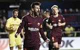 Barcelona forward Lionel Messi celebrates after scoring during the Spanish league football match between Villarreal CF and FC Barcelona at La Ceramica stadium in Vila-real on December 10, 2017. (AFP / JOSE JORDAN)
