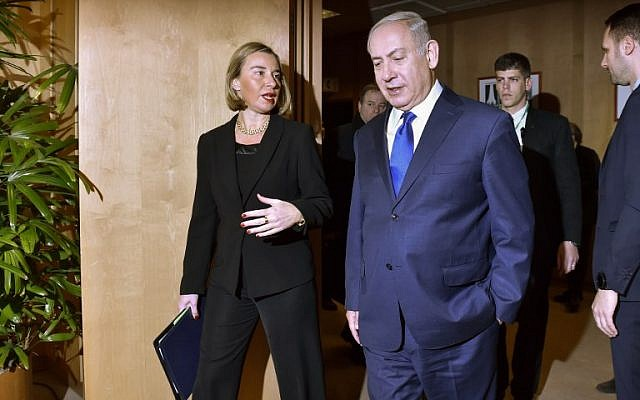 EU foreign policy chief Federica Mogherini speaks with Prime Minister Benjamin Netanyahu as he arrives for their meeting at the European Council in Brussels on December 11, 2017. (AFP Photo/Pool/Eric Vidal)
