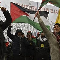 People wave Palestinian flags during a protest gathering near the EU headquarters in Brussels on December 11, 2017. (John Thys/AFP)