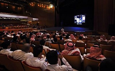 "This file photo taken on October 20, 2017 shows Saudis attending the ""Short Film Competition 2"" festival at King Fahad Culture Center in Riyadh. (AFP PHOTO / FAYEZ NURELDINE)"